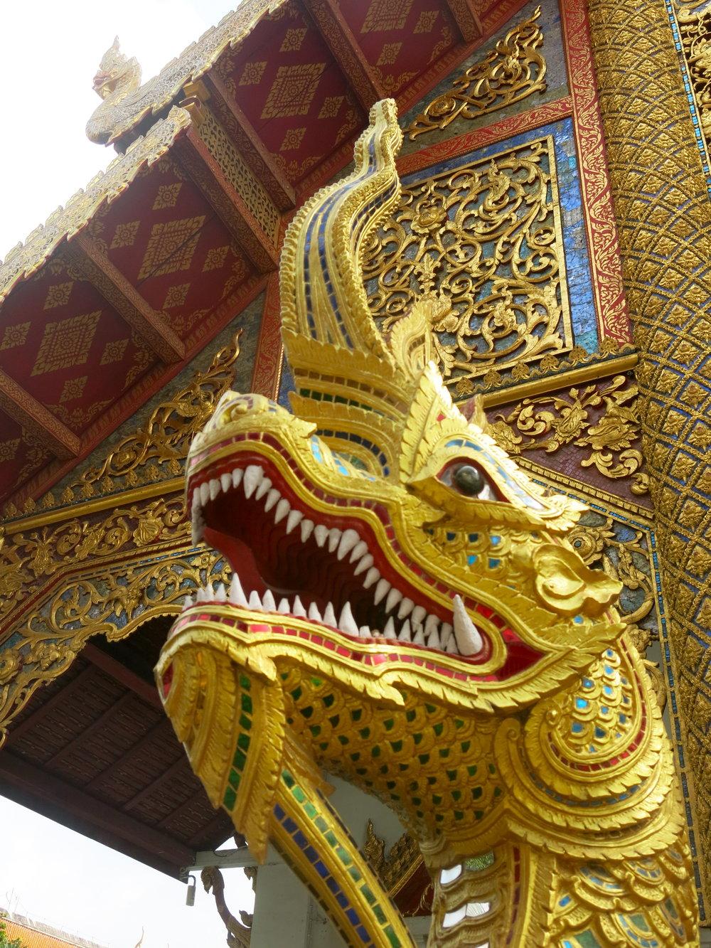 A golden Naga, a dragon-like figures guarding Buddhist temples
