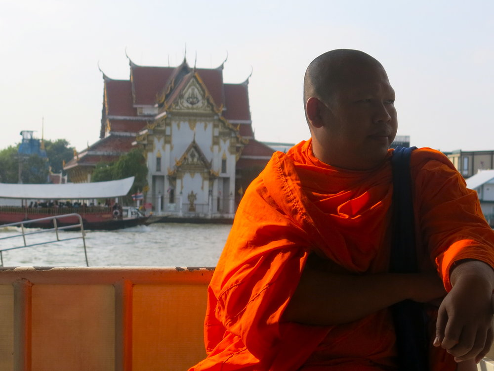 Crossing the Chao Phraya river with a monk to reach Thonburi