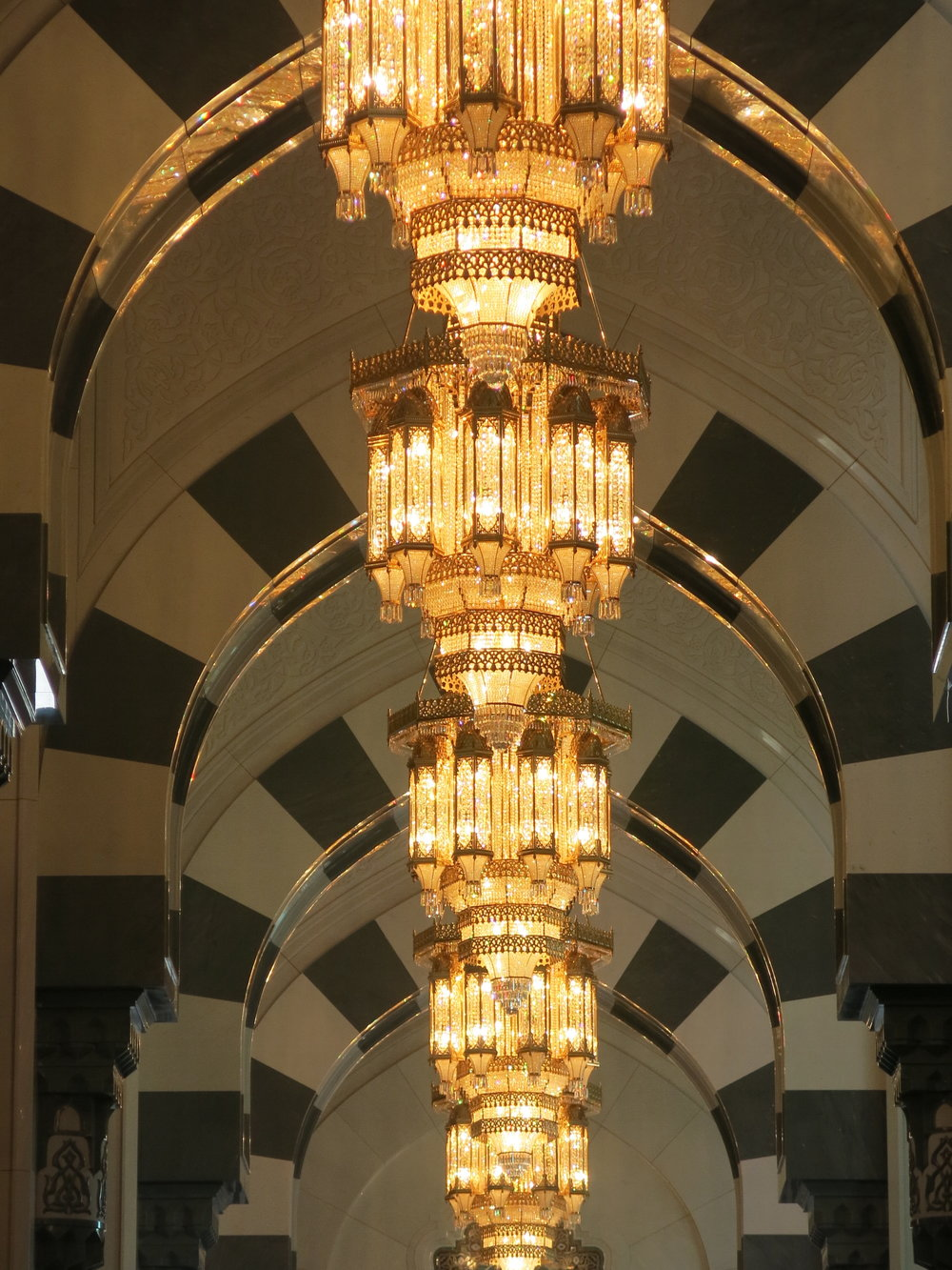 Wonderful alignment of chandeliers in a side gallery