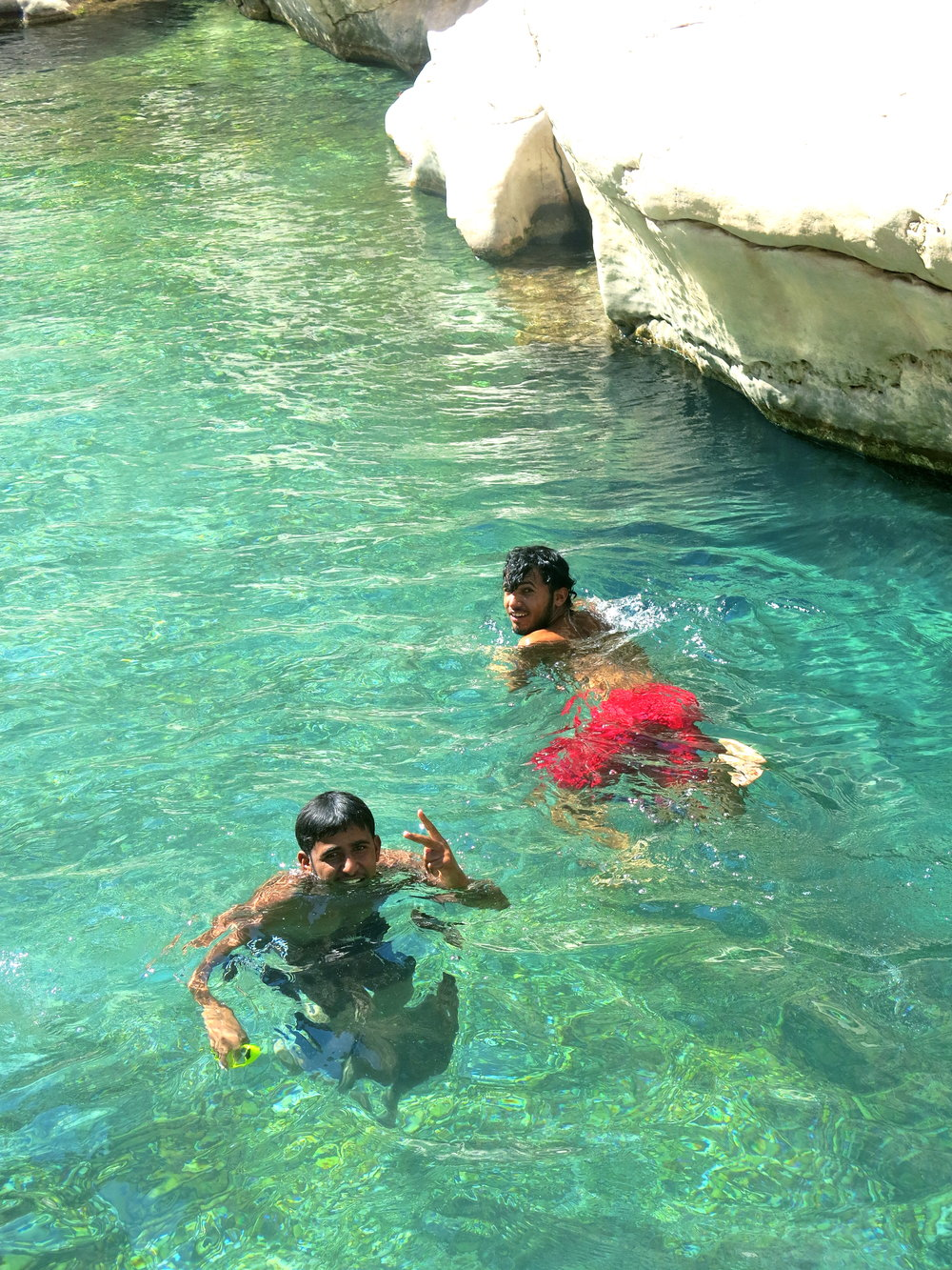 Omani boys swimming with us. No tourist around.