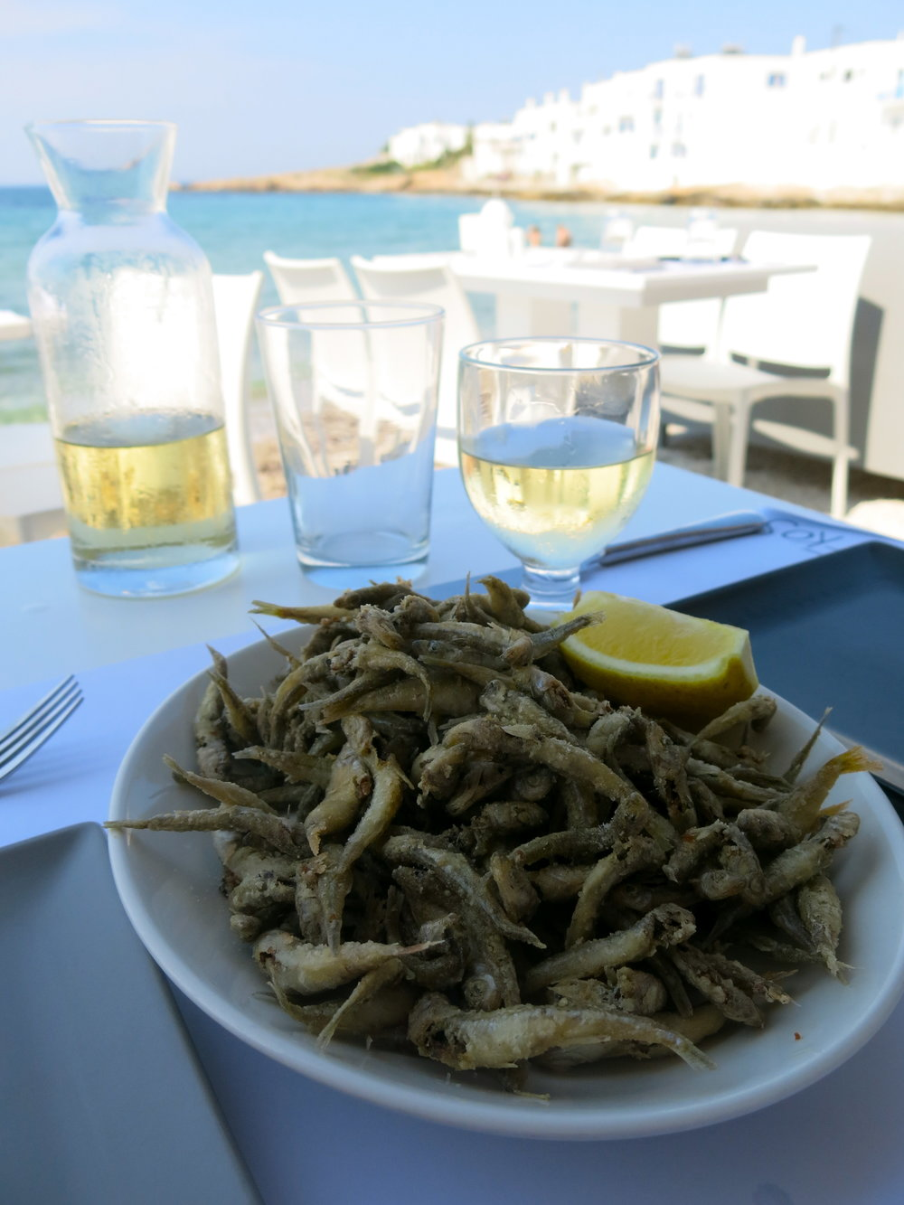 Fried fishes with a glass of Moraitis wine in Naoussa