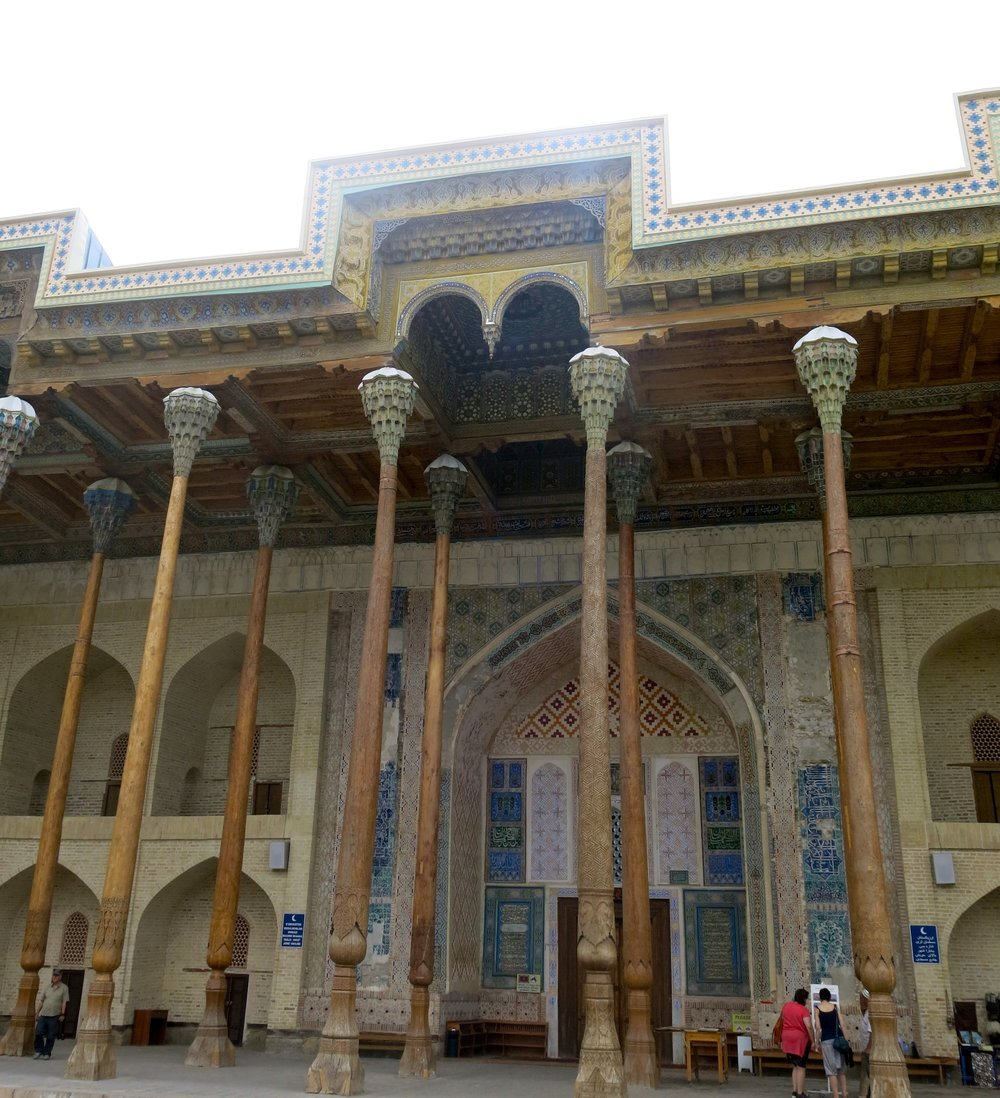 The wooden pillars with their colorful muqarnas at the top
