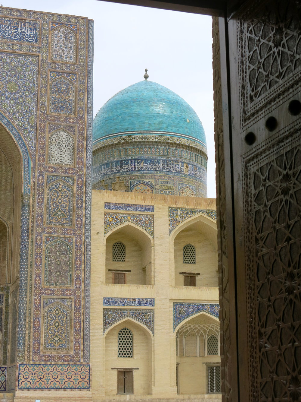 View on the madrasa from behind the doors of the mosque