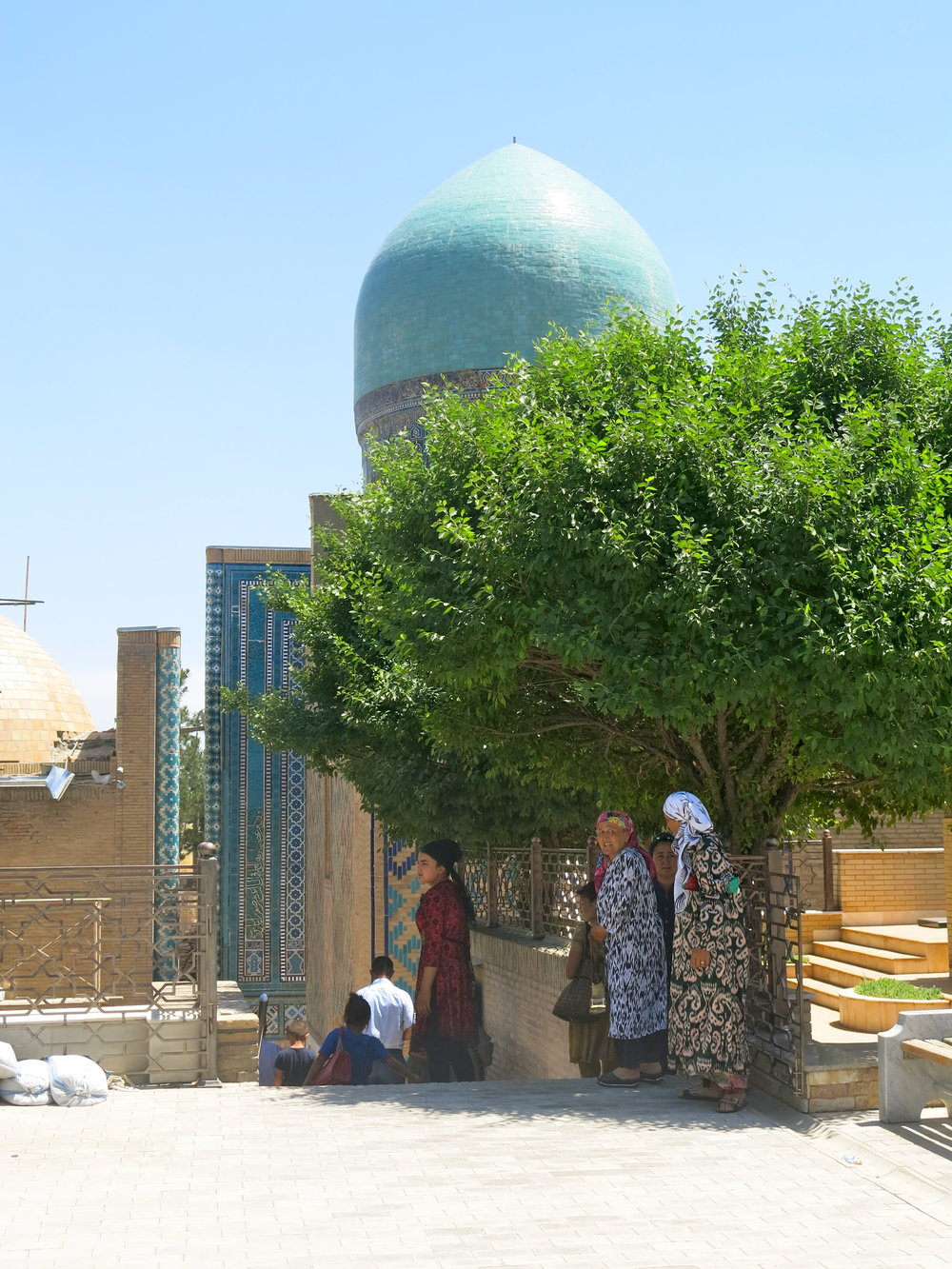 Women in traditional dresses at the Shah-i-Zinda mausoleums
