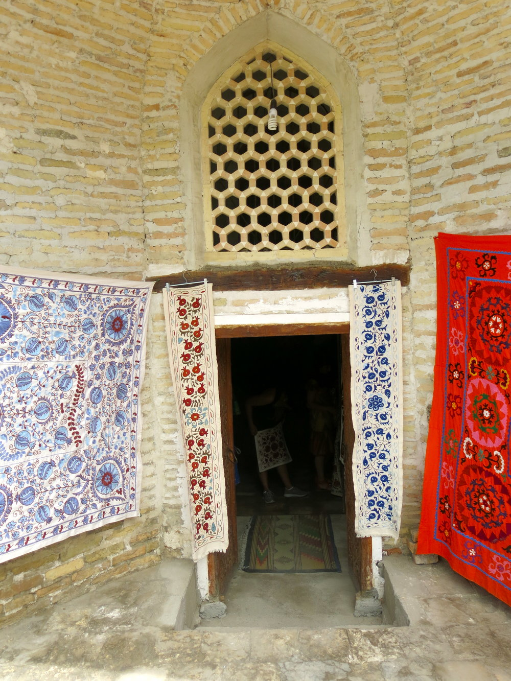 Suzani in a shop within the ancient trading domes of Bukhara