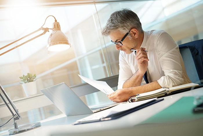 businessman-at-desk_mobile.jpg