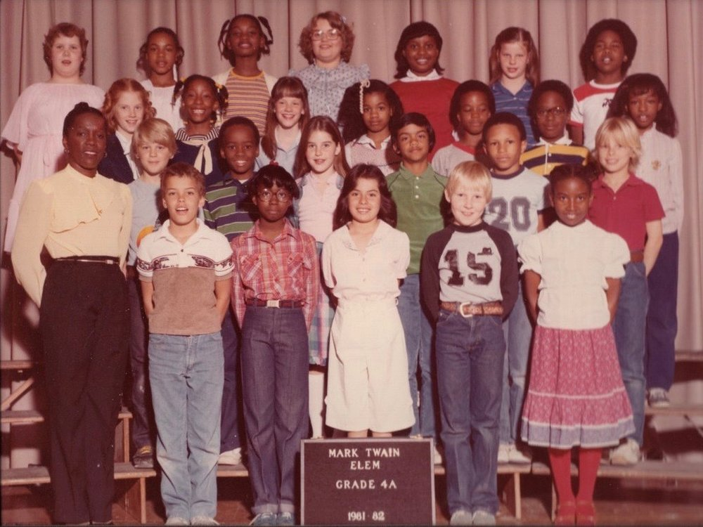Julie (second row, far left) with her fourth grade class