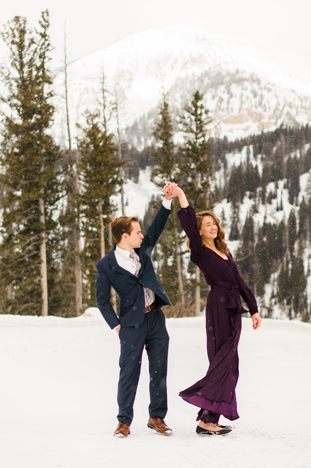 The purple and navy allow my husband and I to stand out against the snowy, white landscape