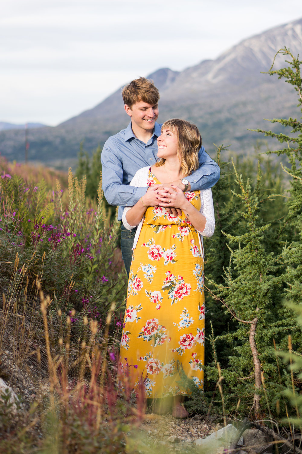 Scott's light blue button-up complements Kerri's yellow dress so well! And her floral print also complements the wildflowers in the foreground.