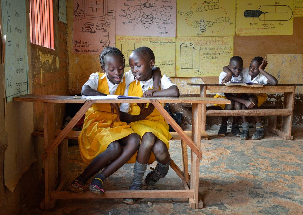 Students at the Rosanna Junior School that Jim Koenigsaecker helped build in the village of Kyebando, Uganda