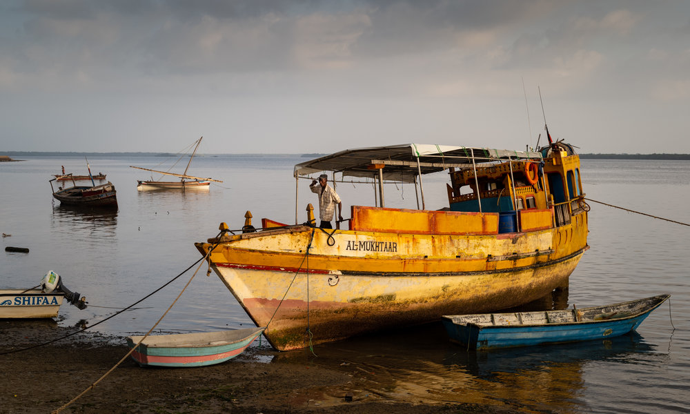 The al-Mukhtaar moored to the shore of Lamu, Kenya at low tide