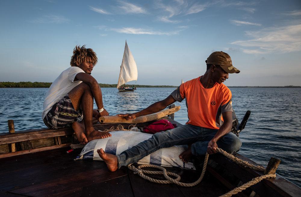 Sailors aboard a jahazi – a type of dhow – off the coast of Lamu, Kenya