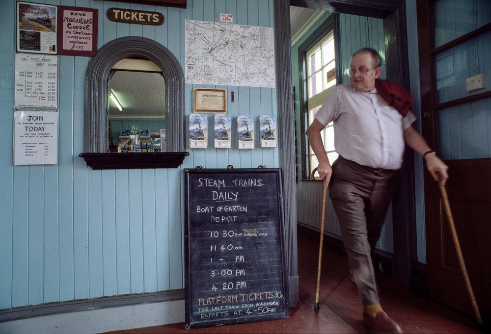 A ticket salesman in the Strathspey Railway station in Aviemore, Scotland