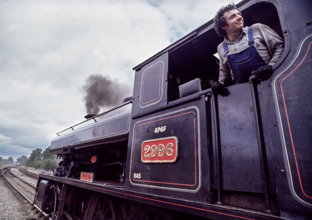 A fireman looks back as a Strathspey Railway train leaves the station in Aviemore, Scotland