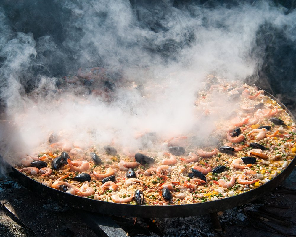Paella - A scrumptious traditional rice dish that can contain Seafood, meat or vegetables.