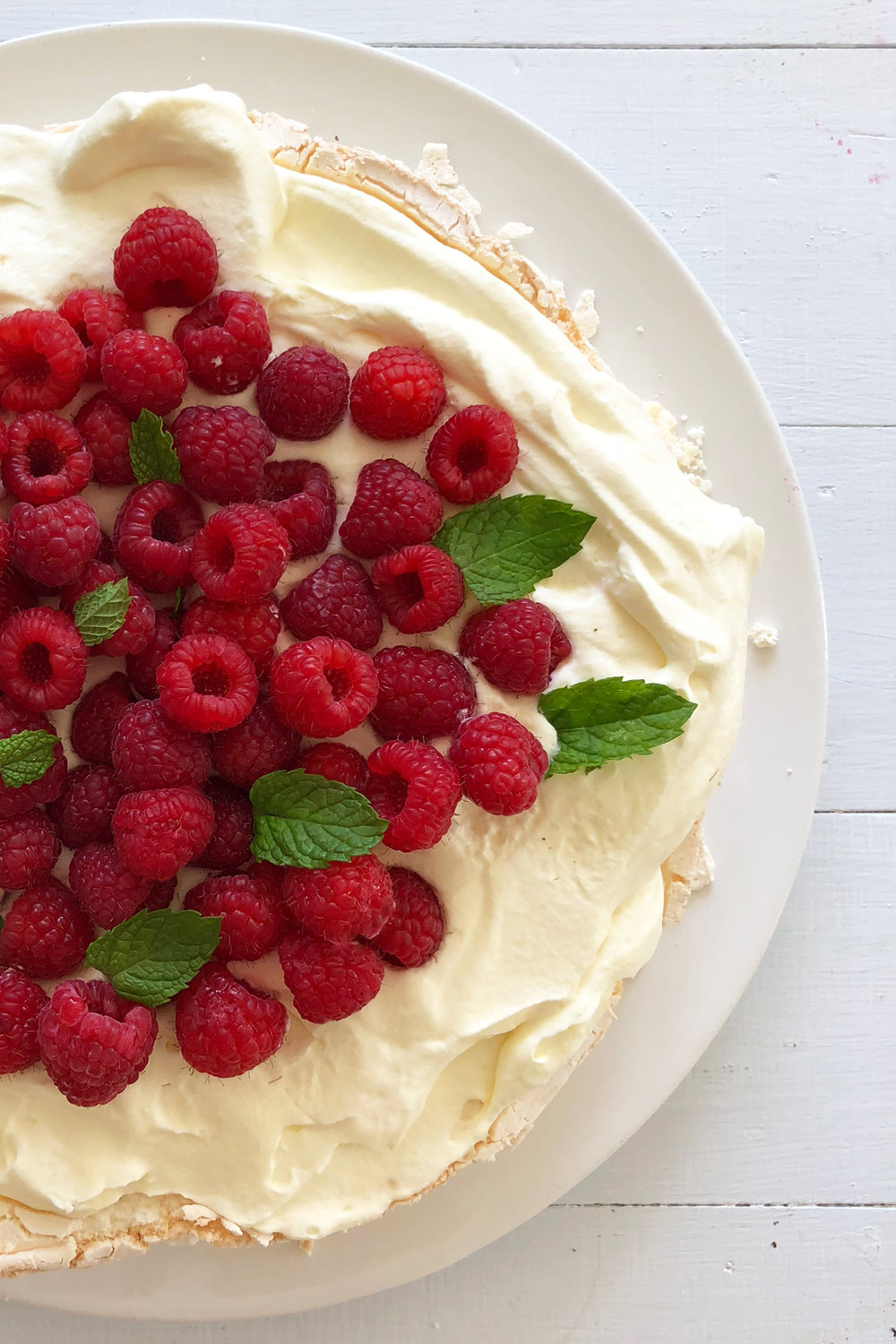 CLICK TO BUY:  Woolworths Pavlova Base, $6 ;  Woolworths Thickened Cream, $2.60;   Driscols Fresh Raspberries, $4.60 (subject to change)