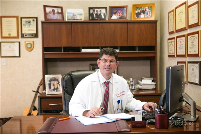 Dr. Scott in his office