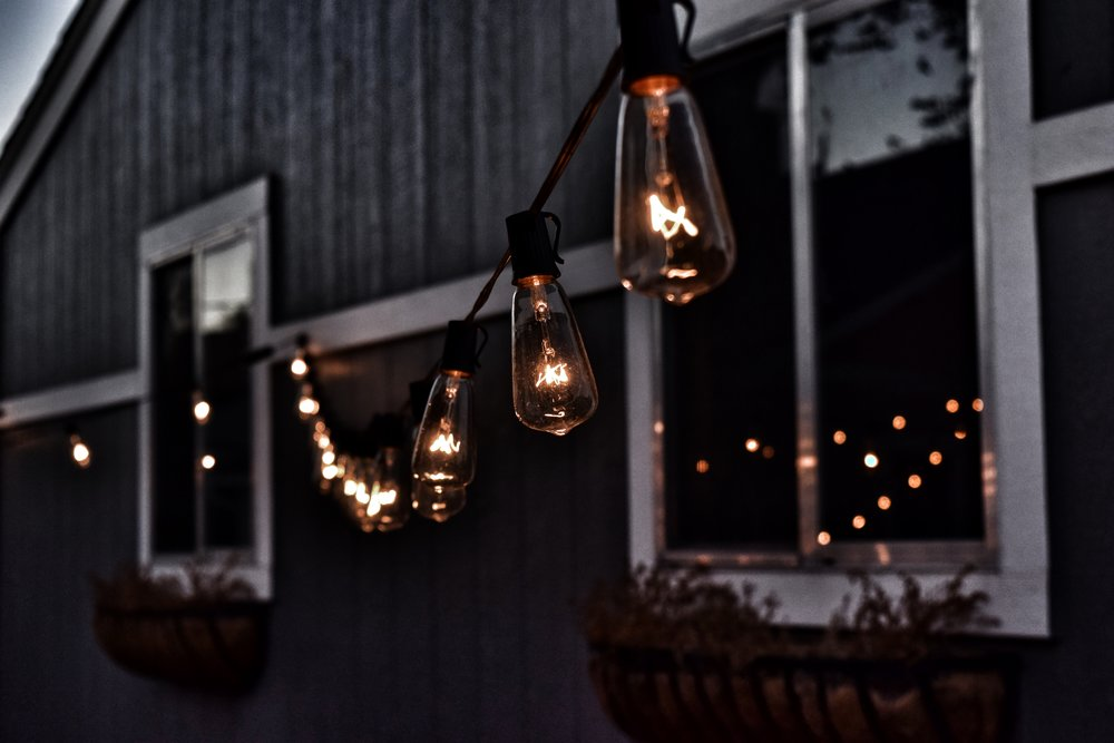 A string of outside lights lit and providing cozy feeling