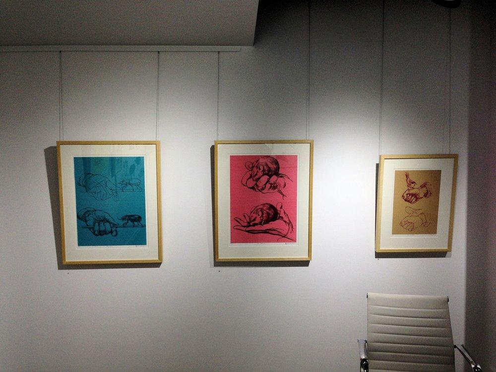 Installation views three lithographs.