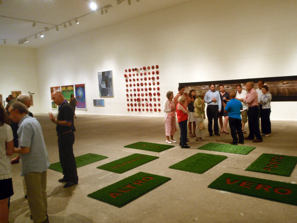 Sebastian Di Mauro discusses his work  Welcome Mats  with visitors to the opening