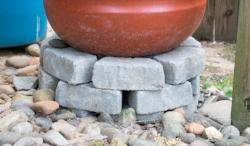 Build a sturdy rain barrel base so gravity can create good water pressure.
