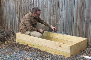 Leveling the raised bed on a sloped driveway.