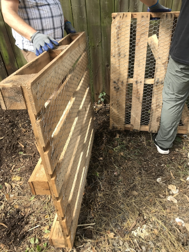 fitting pallets together for compost bins