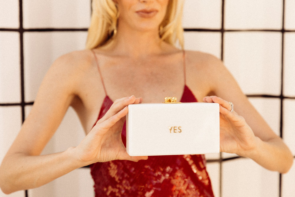 - This Edie Parker clutch says it all for me, from my excitement over my little girl wanting to take piano lessons to my husband (finally) cleaning out the garage to my answer to a glass of champagne over the holidays, YES .... xx