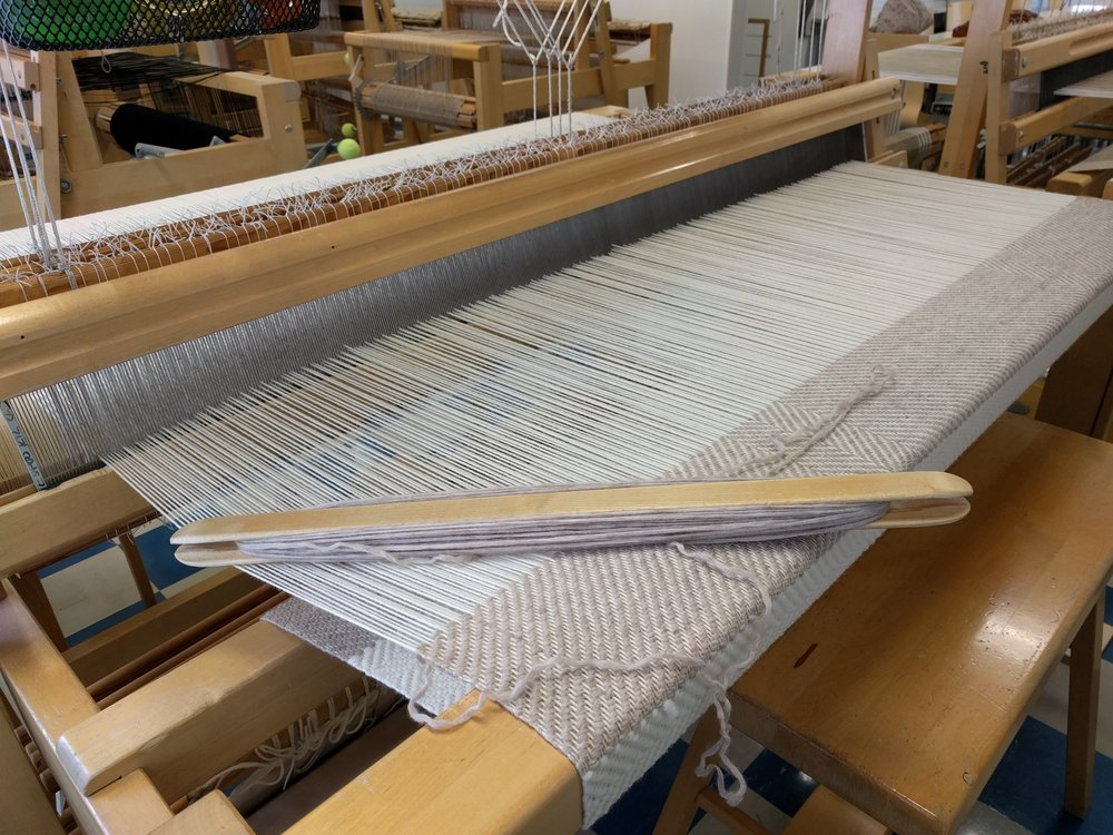 Handwoven blanket made with recycled yarn from a knitted cardigan. Woven in the  Omnia  weaving station in Leppävaara.