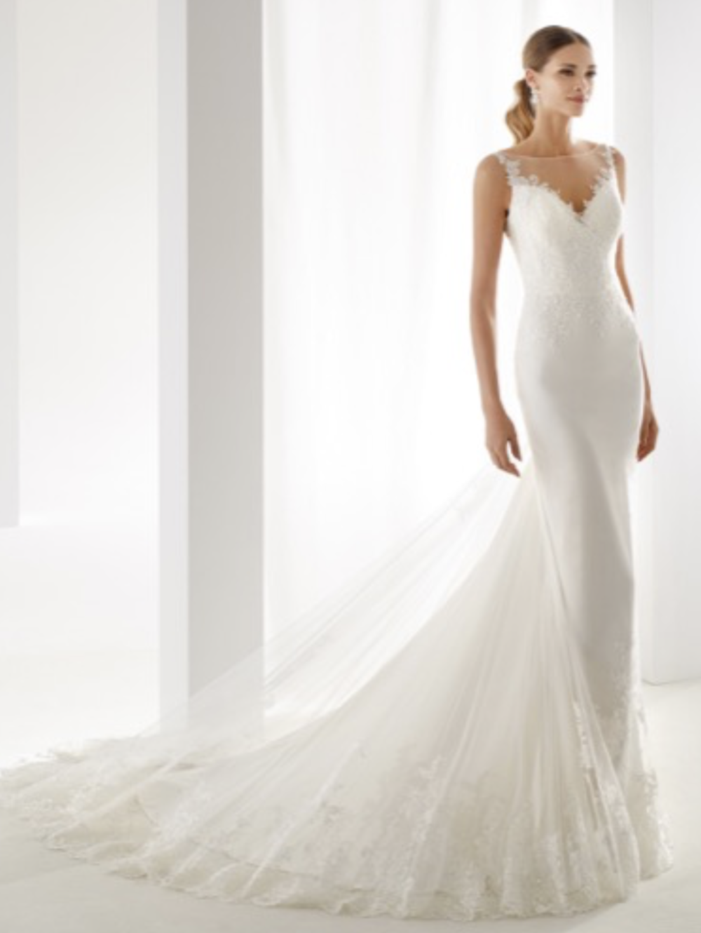Platinum - Aurora Collection By NicoleNECKLINE TYPE: Sweetheart neckline with illusion.BACK DETAIL: High back.EMBELLISHMENT DETAIL: Hand beaded detailColour: Ivory