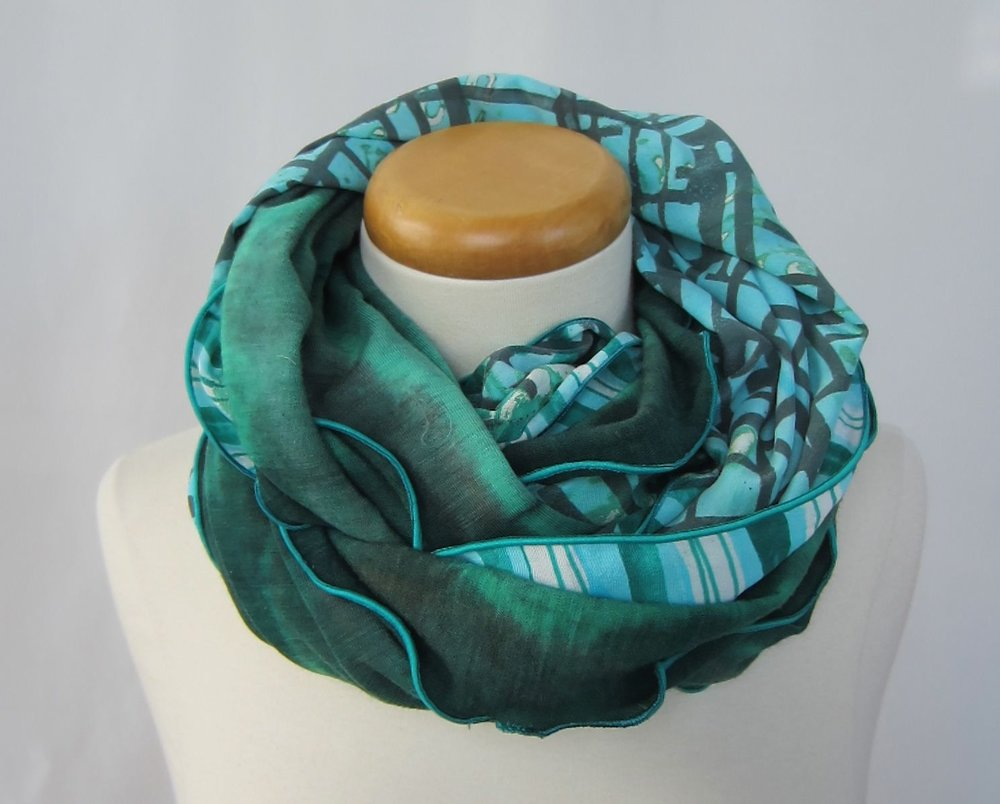 2 circle scarves one wool the other silk.jpg