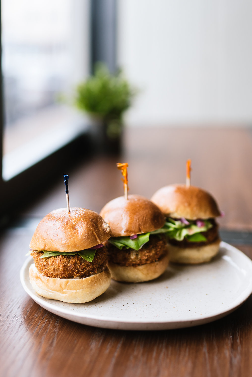Pork trotter sliders - brioche, roasted garlic mustard, greens