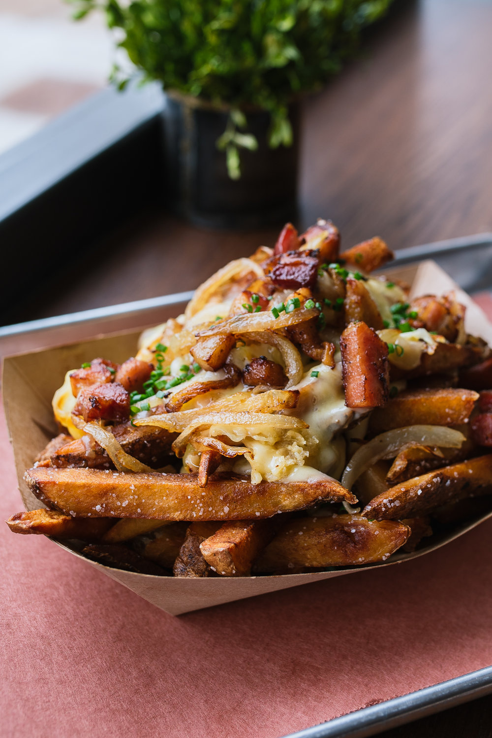 Loaded cheese fries - raclette, house bacon, onions, chives