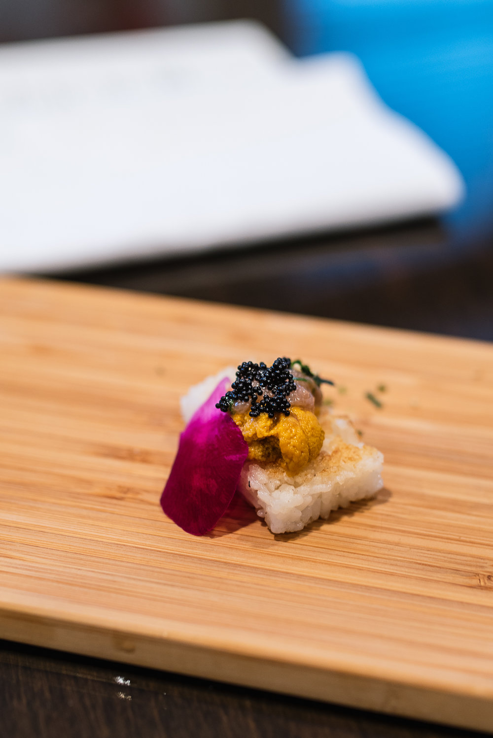 Uni on Crispy rice - fresh wasabi, tuna, tobiko