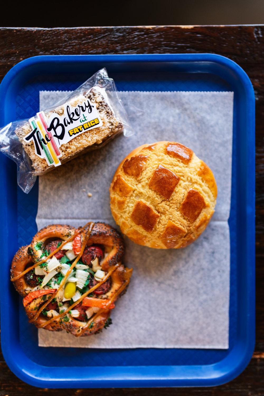 Baked goods - Ube Milk Barpurple yam, shortbread, condensed milk jam, coconut streuselPineapple Bunchinese BBQ pork, scallionChicago-style hot dog bunvienna beef, Chicago-style classic fixins'at The Bakery at Fat Rice