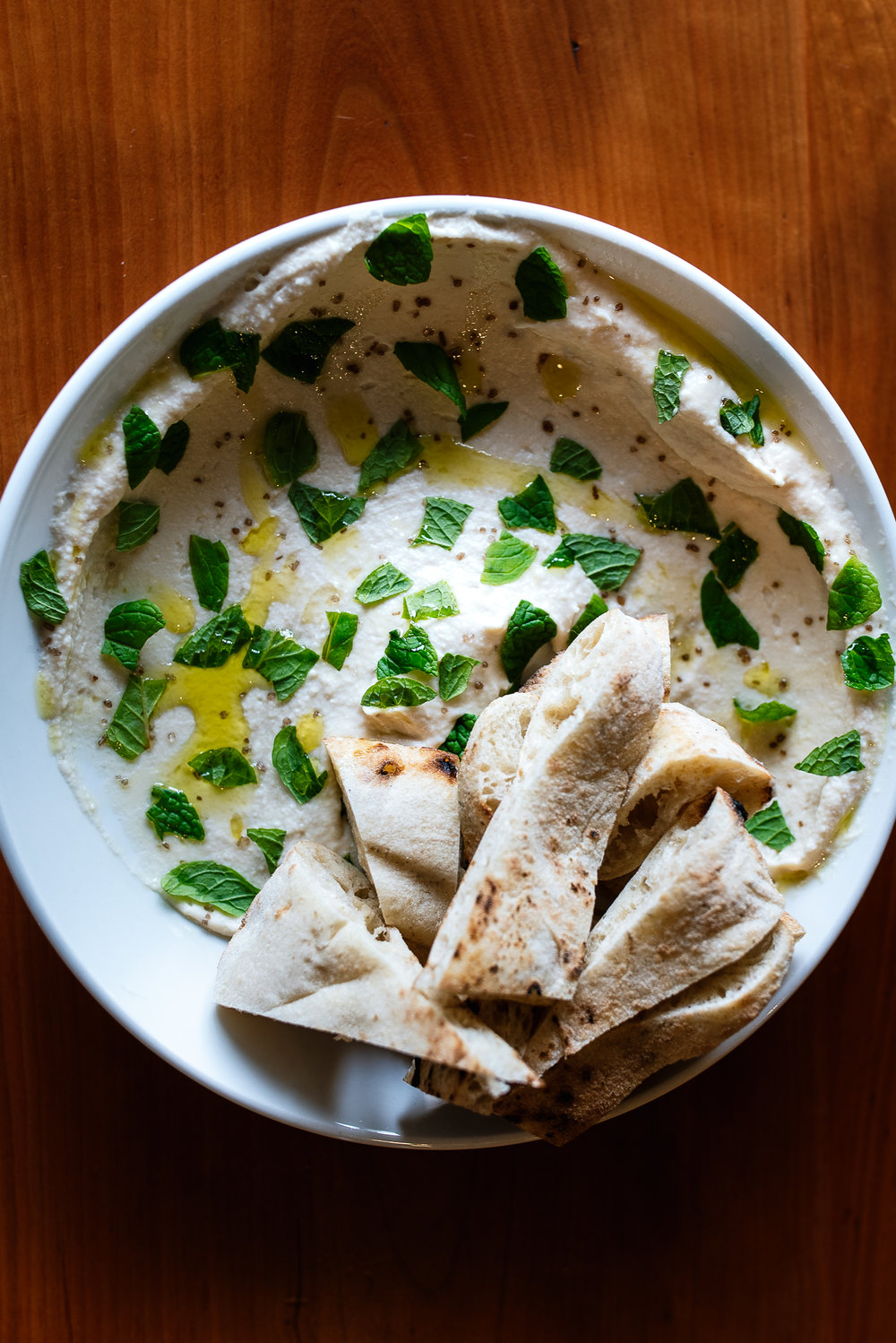 White bean hummus - mint, hearth breadSimple—but with the addition of the pop of mint and drizzle of high quality olive oil, perfection.
