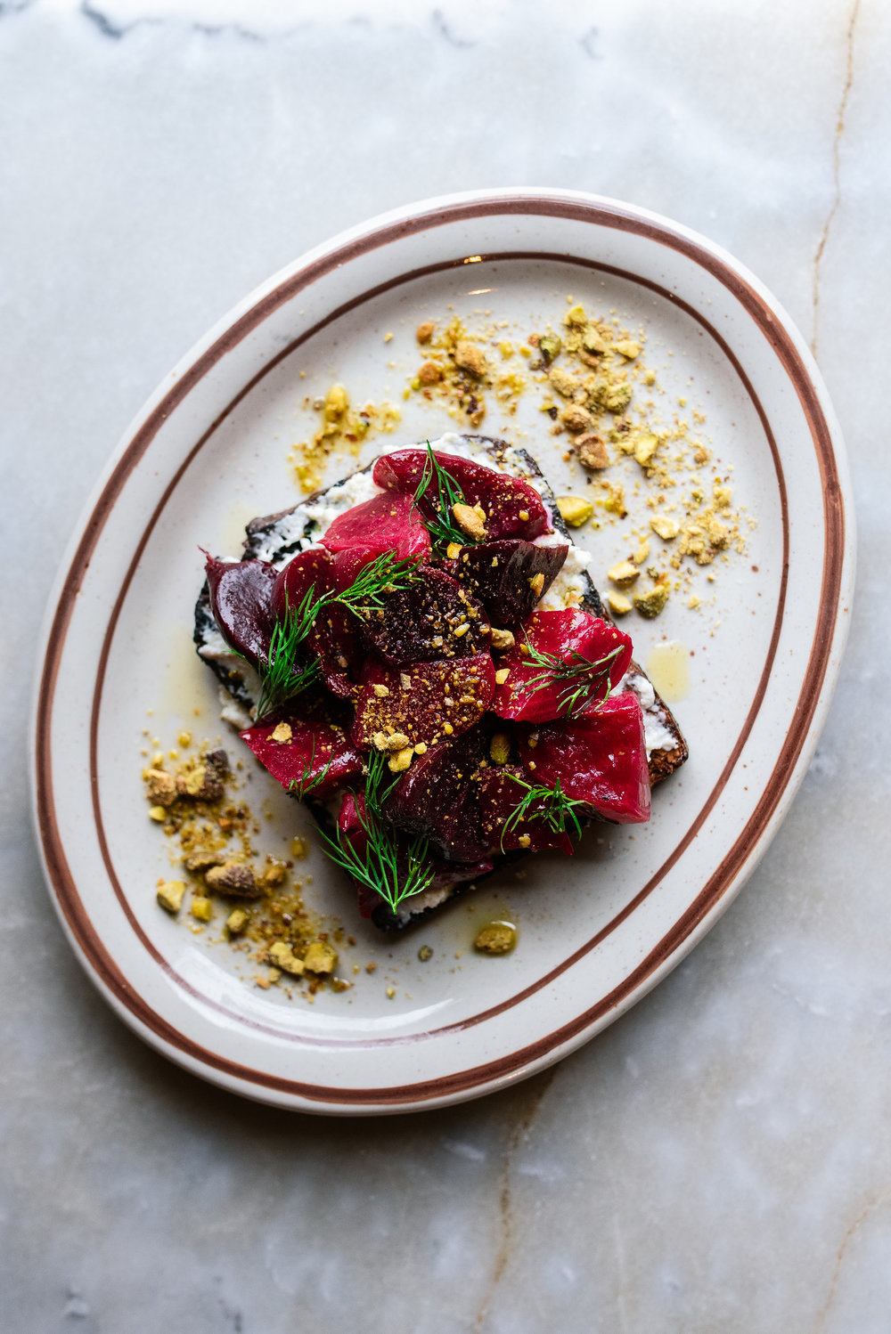 beet bruschetta - red, golden & chioggia beets, Union Loafers' German rye, whipped ricotta, toasted pistachios