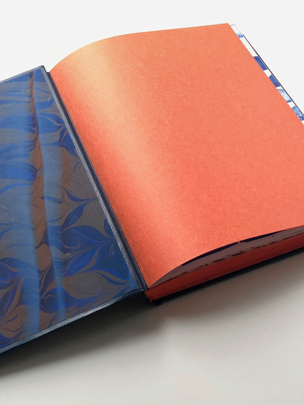 Hand-marbled pastdowns and Japanese paper flyleaf