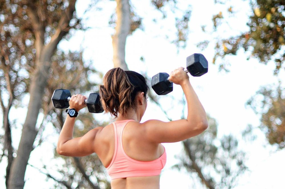 strong woman carrying weights