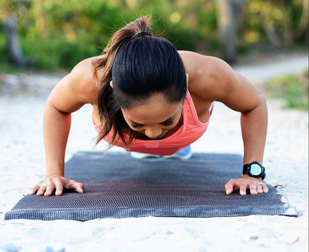 toned woman doing push ups