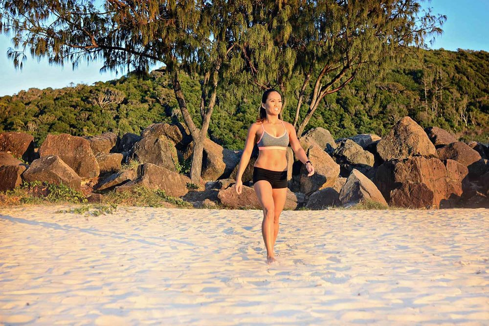 fit woman walking on the beach