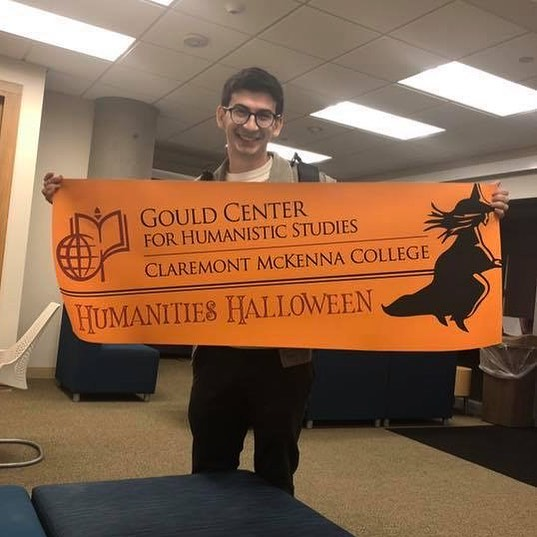 "Jack Gleiberman '19 is a Philosophy and PPE dual major from Los Angeles! He is a student manager at the Gould Center, and is excited for Humanities Halloween this Wednesday from 11 AM - 1 PM in the Center! ""My experience at CMC has been deeply informed by engagement in the humanities. Entering Claremont in pursuit of a degree in finance, my winding path was forever changed when I took my first course in philosophy with Professor Rajczi. I have been zealous about philosophy ever since; I am infinitely grateful that my passion has been nurtured by the exceptional and dedicated philosophers who call CMC their home. To me, one of the notable virtues of philosophical inquiry consists in its refusal to take anything as given. The philosophical sensibility – a sensibility found within us all – demands reasons, justification, and evidence for our beliefs, our traditions, our norms. The curiosity of the philosopher is the impetus for questions of why and how. When done well, philosophy should devastate our sense of hubris and make us reconsider our biases of time, space, and social positioning. It is this critical dimension of philosophy that has motivated me to pursue a career in criminal justice. I hope to one day serve my community as a public defender, where I can use my training in philosophical inquiry in service of defending those that are routinely neglected by our social structures."" #MajorMonday"