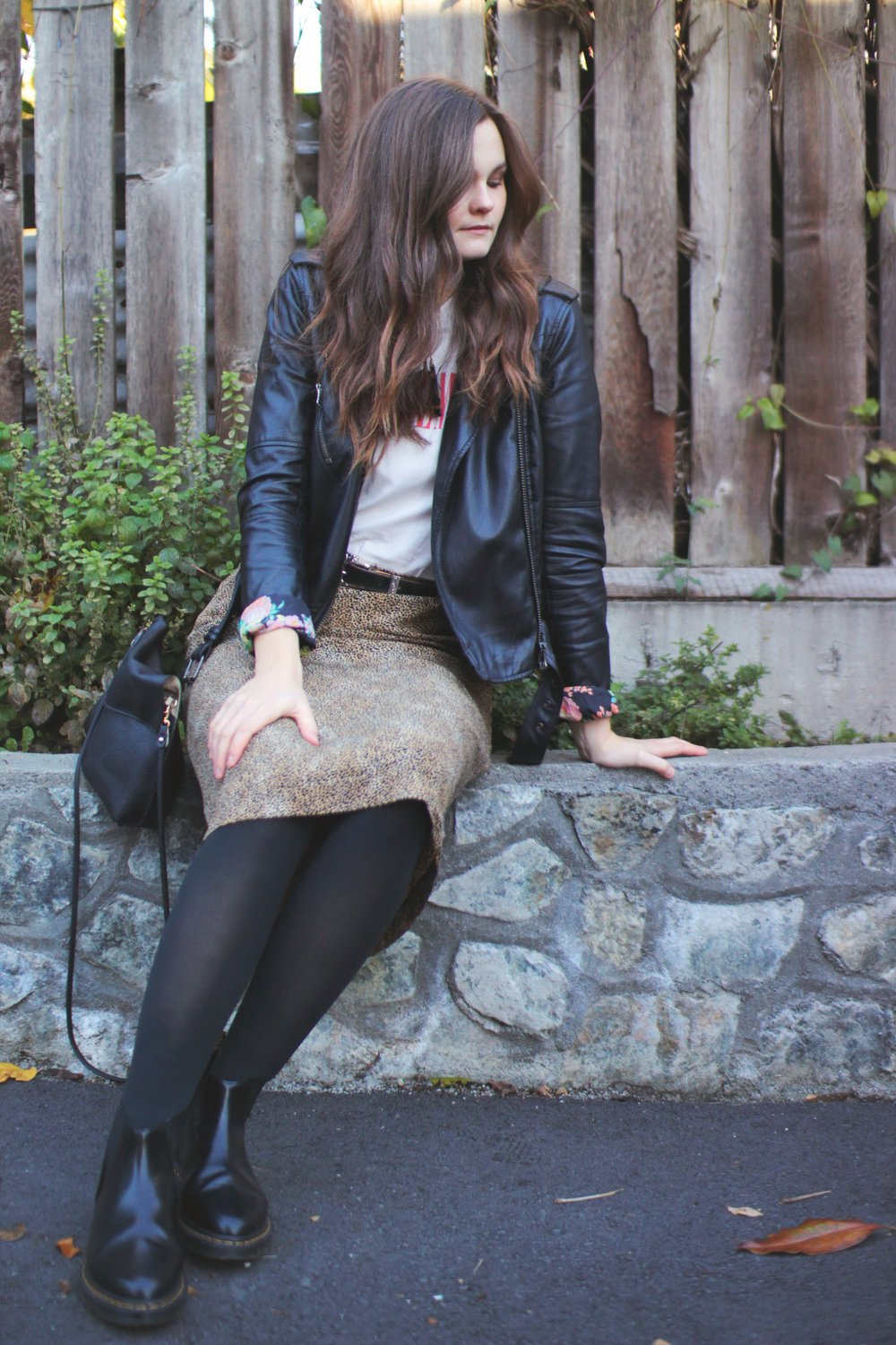 Boots: Doc Marten, Skirt: thrifted, Purse and teeshirt: Urban Outfitters, Biker Jacket: old Garage (similar one  here )