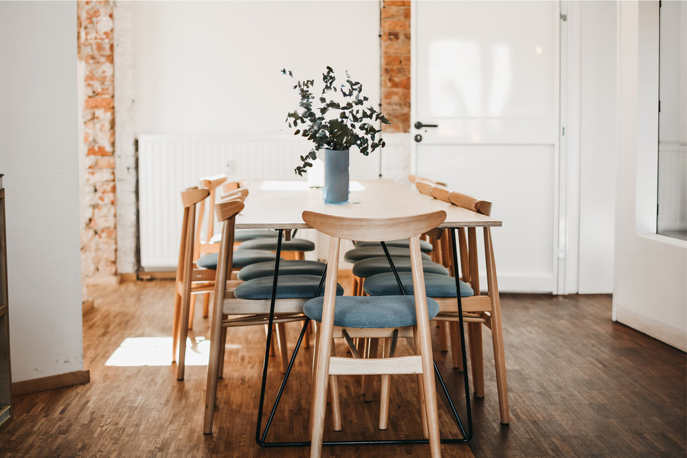 dining room with fresh eucalyptus branches in vase centerpiece