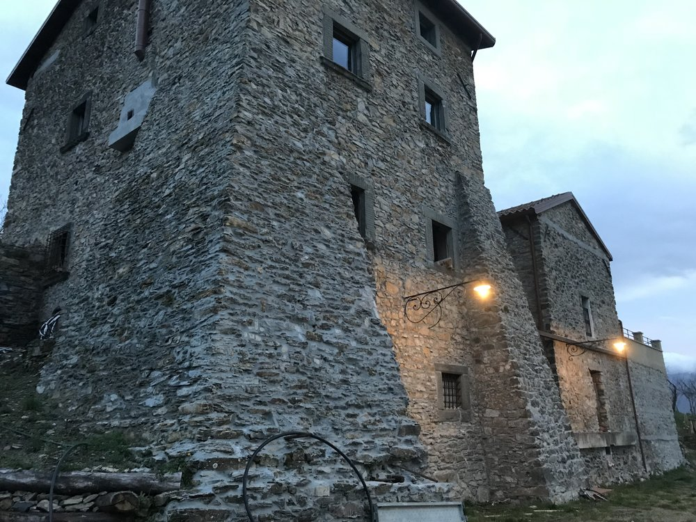 Medieval stones dominate… disguising the houses within.