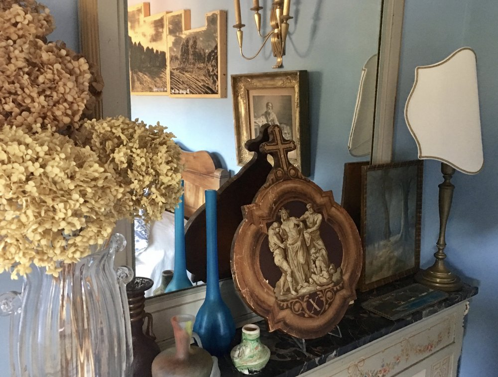 Objects on the mantelpiece in the Master BR.