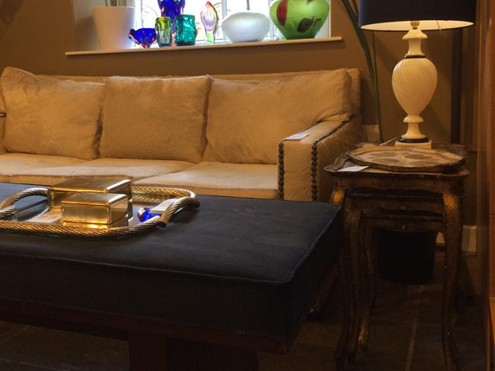Harrods Charlerois hide sofa, restored gallery bench. Italian alabaster lamp.