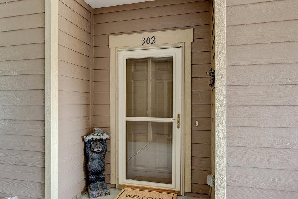 8779 S Kipling Way #302_FrontDoor.jpg