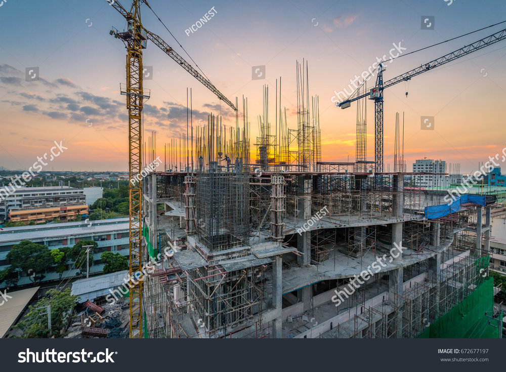 stock-photo-epic-colorful-twilight-of-a-new-hospital-building-being-constructed-with-big-cranes-at-chonburi-672677197.jpg