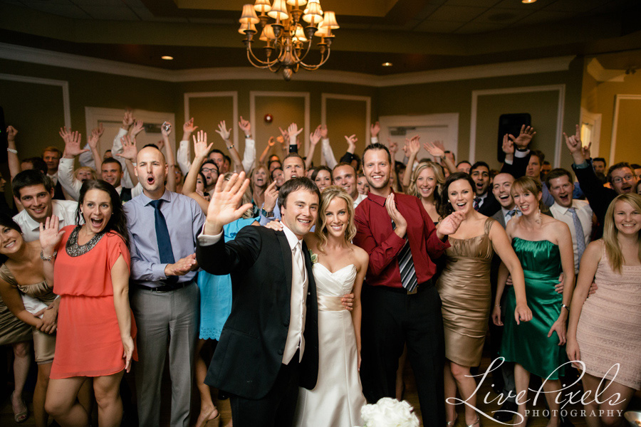 """fun crowd and happy bride and groom at their oakville wedding"""